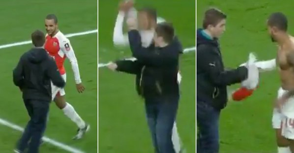 WATCH: Theo Walcott pulls fan from the crowd, celebrates with him and gives him shirt