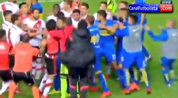 WATCH: A headbutt on Carlos Tevez causes a 40-man brawl at Boca vs River Plate!