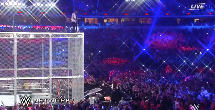 VIDEO: Shane McMahon Jumps Off 20ft Cell Into Announce Table
