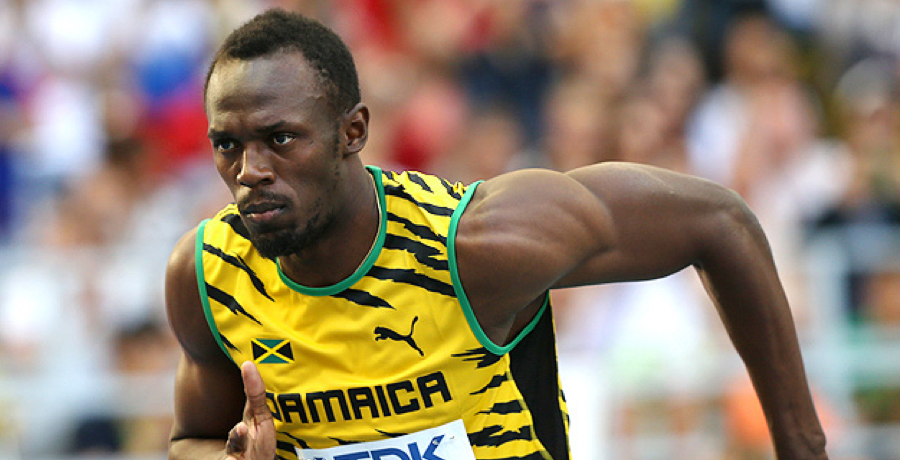 PIC: Usain Bolt Posts Image Of Himself Topless With Semi-Naked Woman