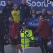 WATCH: Ozil Tries To Throw His Coat At Everton Staff From the Bench, Misses!