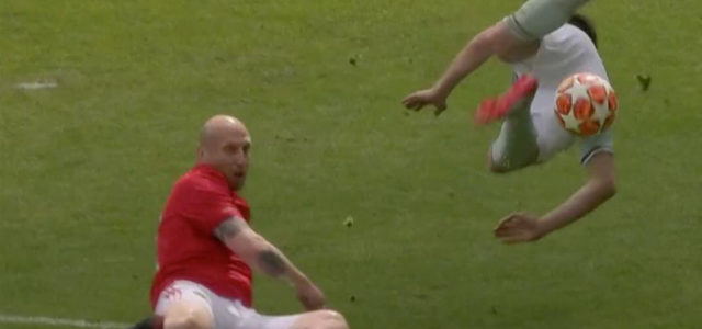 WATCH: 46 Year old Jaap Stam Flattens 3 Bayern Legends In Under 10 Seconds During Charity Match