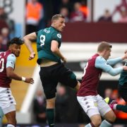 Wood earns late point as Burnley twice battle back to draw at Aston Villa